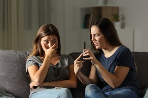 Woman scolding her friend about phon