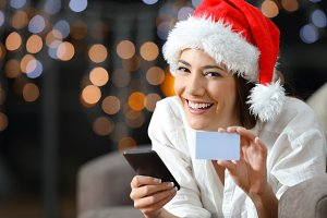 Woman showing a blank credit card on