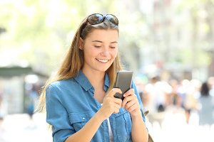 Woman smiling using a mobile phone i