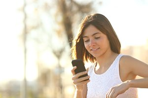 Woman using a smartphone sitting on