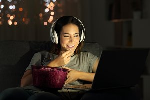 Woman watching online tv in the nigh