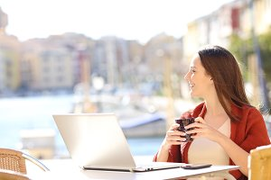 Woman with a laptop looking away in
