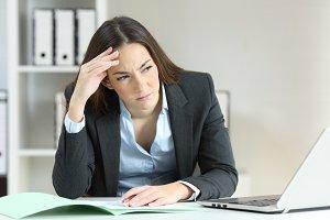 Worried office worker looking at sid
