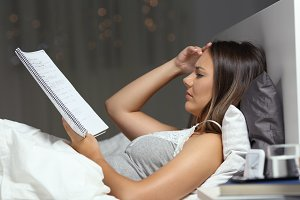 Worried student studying late hours
