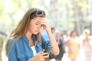Worried woman reading phone content