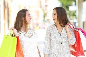 Couple of shoppers talking walking i