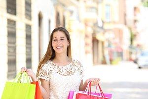 Happy shopper walking alone in the s