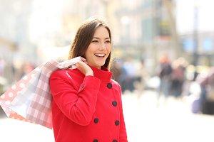 Shopper in winter walking and holdin