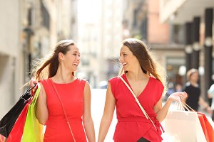 Shoppers talking holding shopping ba