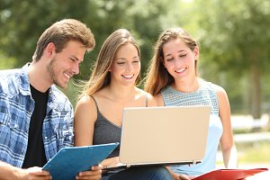 Three students e-learning together i