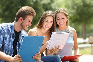 Three students studying together in