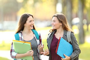 Two students talking walking in the