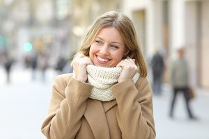 Woman warmly clothed looking a side