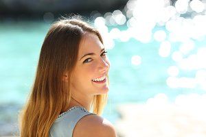Woman with perfect smile on vacation