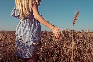 Girl blonde in summer dress. Summer