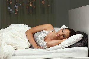 Insomniac woman can not sleep at hom