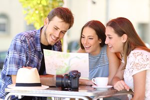 Three tourists planning travel in a