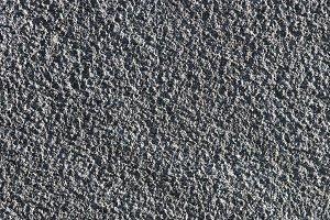 Rough blue granite wall texture