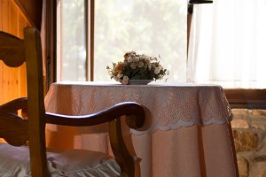 Open window with antique table in a