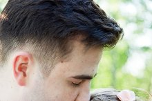 Handsome man kissing his fiancee