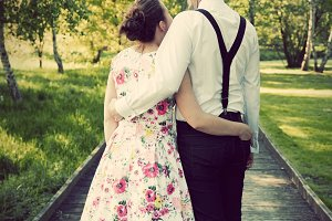 Happy couple standing on wooden path
