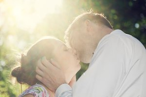Couple kissing with love in sunshine