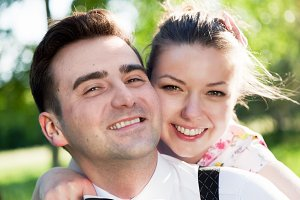 Smiling couple portrait in the park
