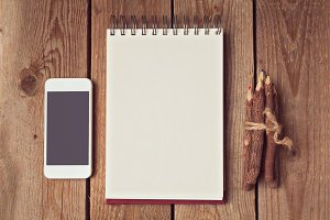 Blank notebook with smartphone