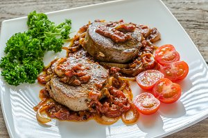 Angus beef steaks with tomatoes