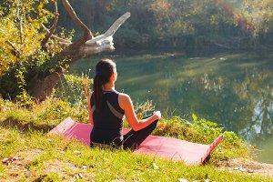 Woman sitting in lotus pose meeting