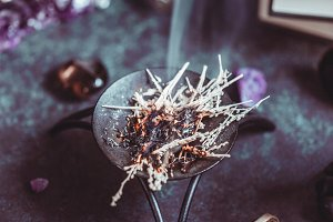 Burning herbs on a witch's altar