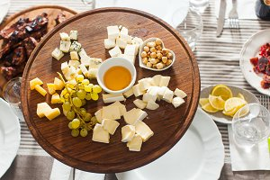 Cheese plate with hazelnuts, honey
