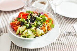 Salad with fresh vegetables, olives