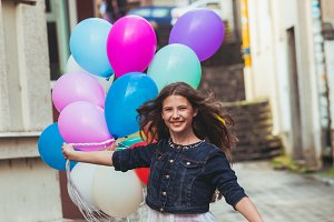 Girl with colorful balloons on the