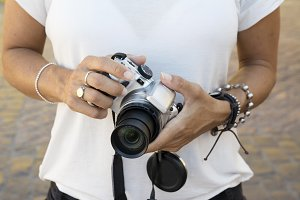 camera woman, With bracelets on the