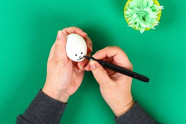 Diy rabbit from eggs for Easter.