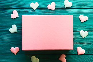 Pink gift box on wooden background