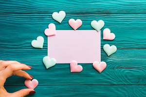 Pink blank card on wooden background