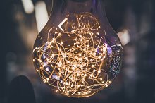 Giant light bulb with light garlands by  in Abstract