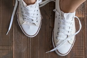 Retro sneakers left on wooden floor