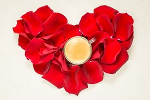 Red roses heart and cup of coffee.