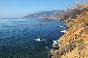 Azure surf on the steep coast