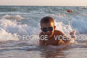 Child is excited with sea waves
