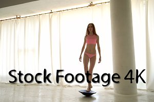 Ballerina is training on hemisphere