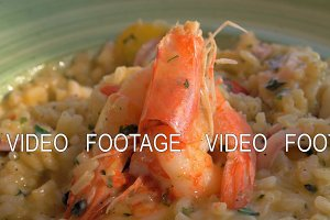 Eating risotto with squid and prawns