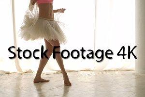 Ballerina rehearsing barefoot