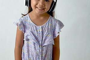little girl listening to music on he