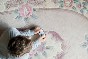 young boy lying on the floor carpet