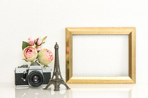 Golden picture frame and camera