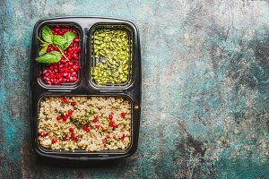 Healthy lunch box with quinoa salad